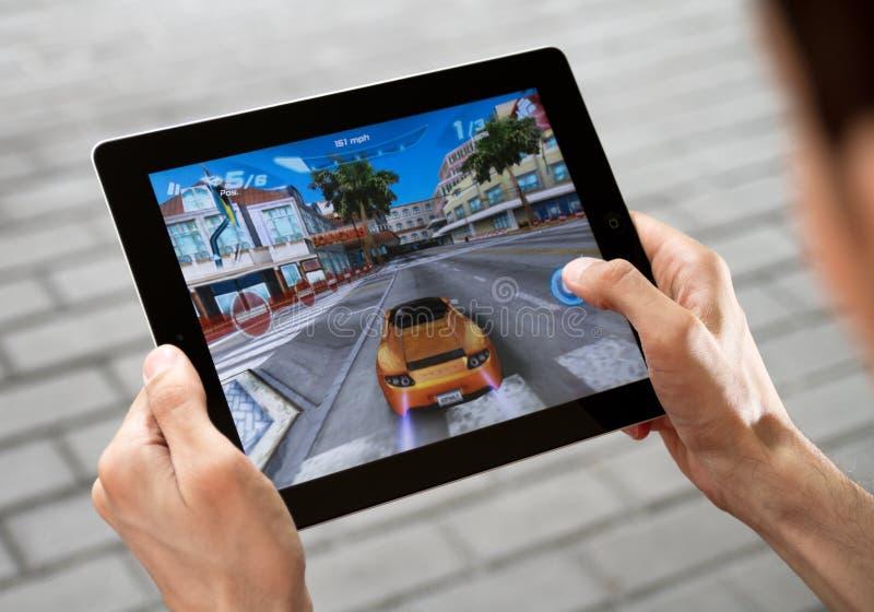 Het Spel van het spel op Appel Ipad2 stock fotografie