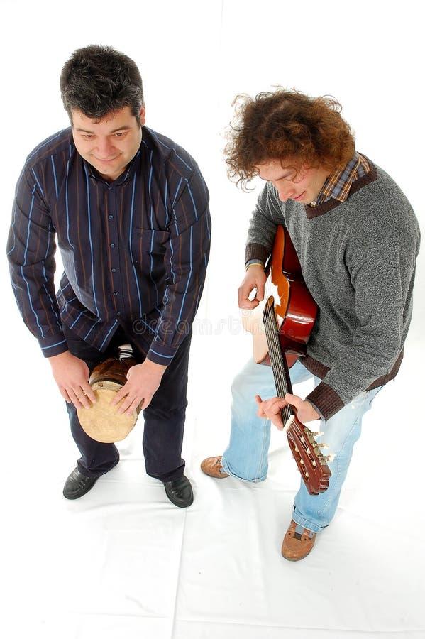 Het spelen deurpost en gitaar stock foto