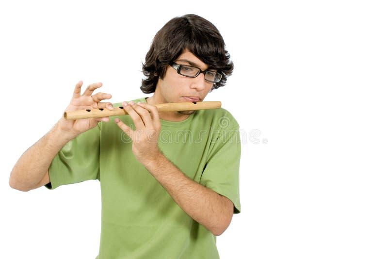 Het spelen met fluit stock afbeeldingen