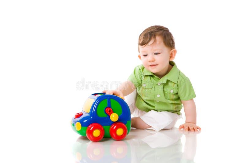 Het spelen van de baby stock foto