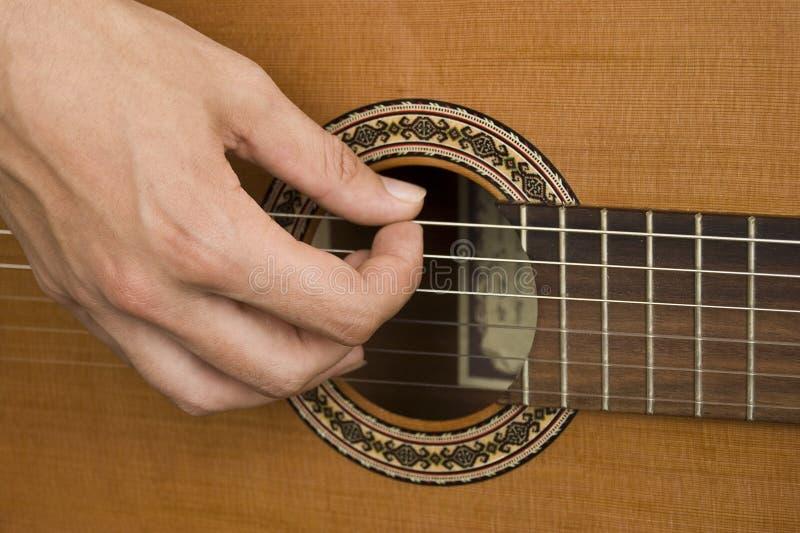 Download Het spelen van de gitaar stock afbeelding. Afbeelding bestaande uit namen - 10778453