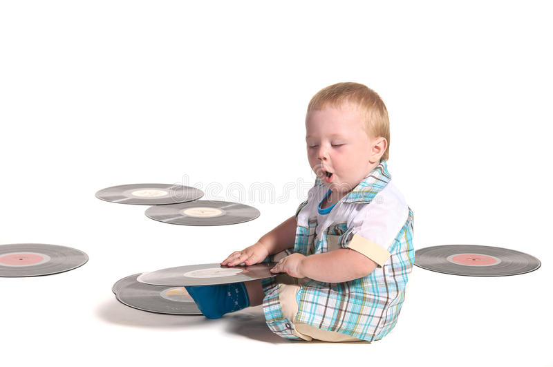 Het spelen van de jongensDJ van de baby met vynilschijven royalty-vrije stock afbeelding