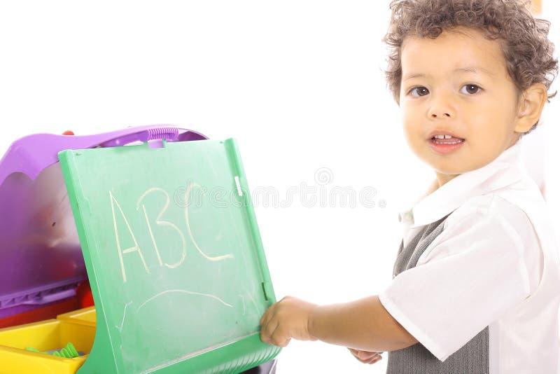 Het spelen van de peuter school stock foto