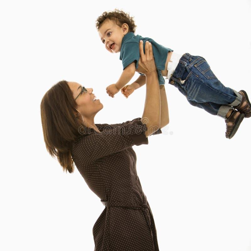 Het spelen van het mamma met baby. stock fotografie