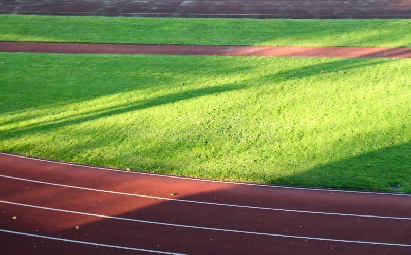 Het spoor van het ras in voetbalstadion stock fotografie