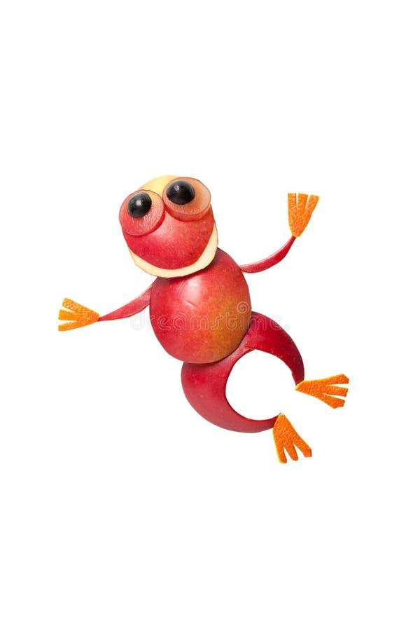 Het springen kikker van rode appel wordt gemaakt die stock foto