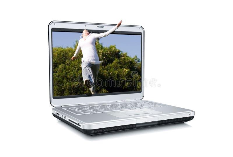 Het springen uit van laptop stock foto's