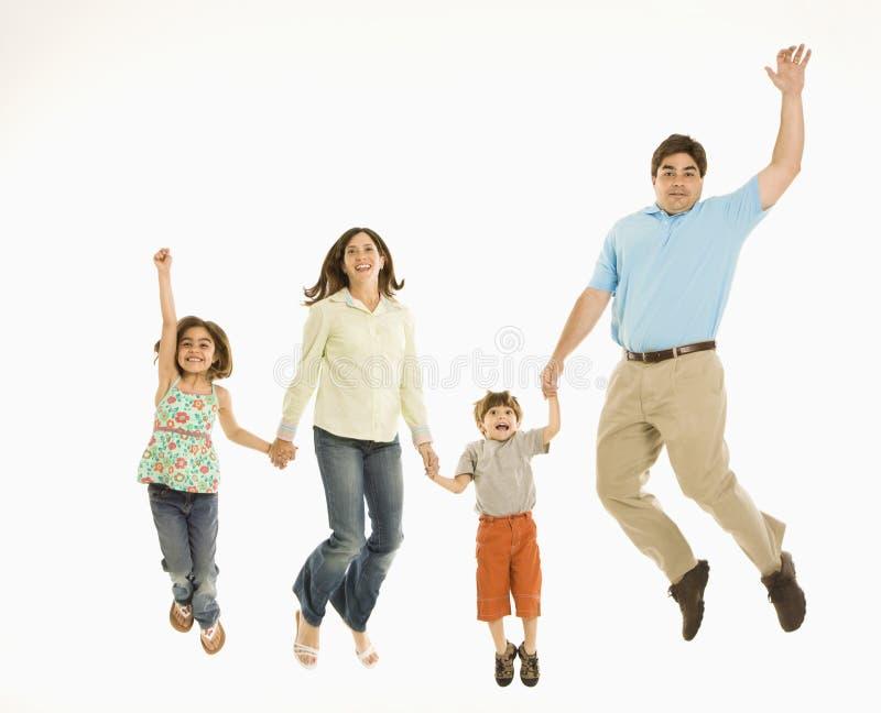 Het springen van de familie. stock foto