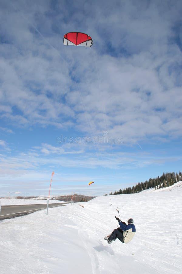 Het springen van Sneeuw Kiteboarder stock afbeeldingen