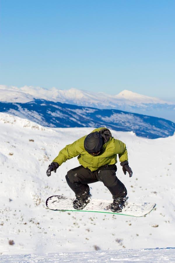 Het springen van Snowboarder stock afbeelding