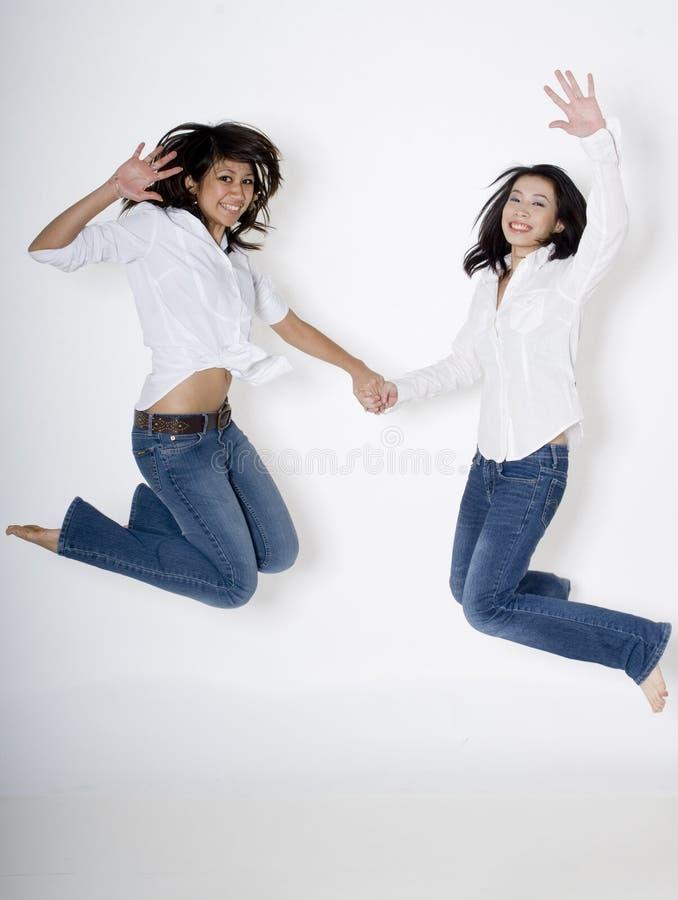 Het Springen van vrouwen stock afbeeldingen