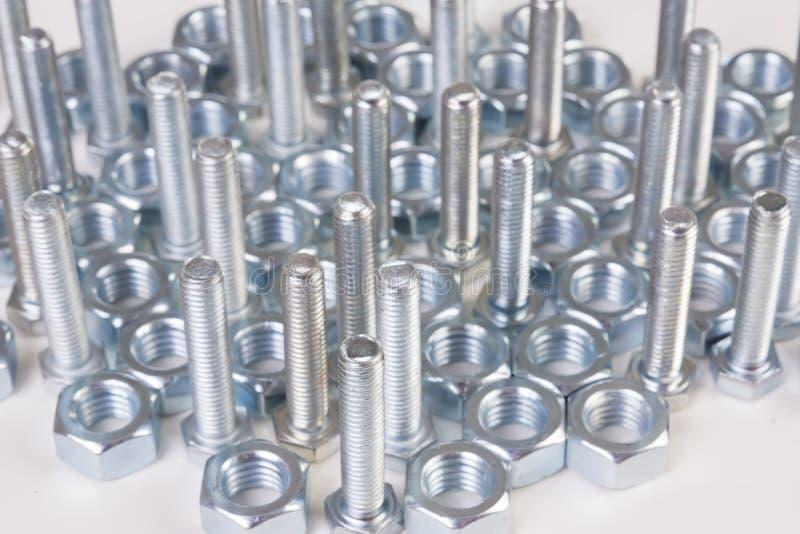 Het staal chromeplated bouten stock fotografie