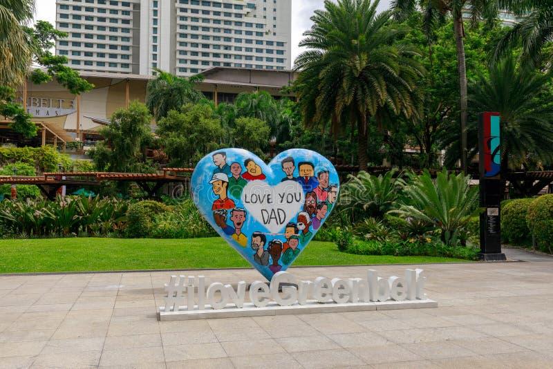 Het standbeeld van de liefdepapa bij Groengordelwinkelcomplex in Metro Manilla royalty-vrije stock afbeeldingen
