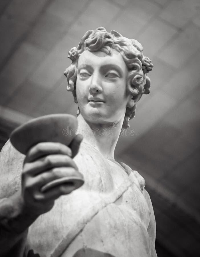 Het standbeeldportret van Dionysusbacchus wine in Louvre stock afbeeldingen