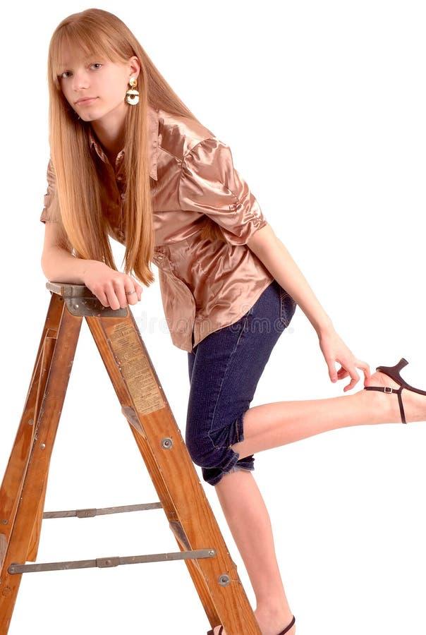 Het stellen van de tiener met ladder royalty-vrije stock afbeeldingen