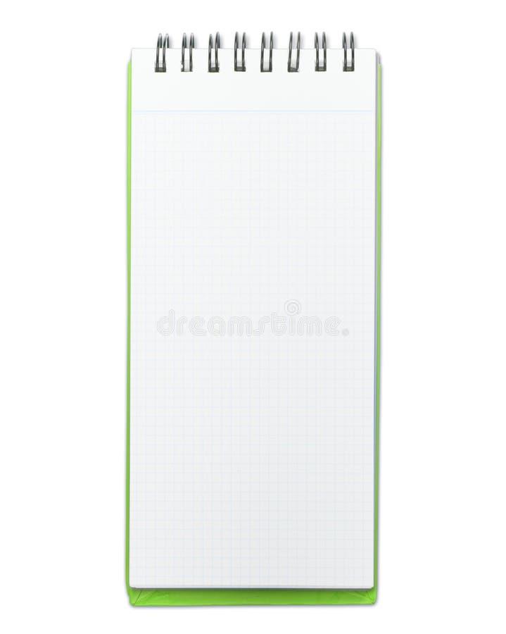 Het stootkussen van het memorandum met groene dekking die op wit wordt geïsoleerdf stock foto