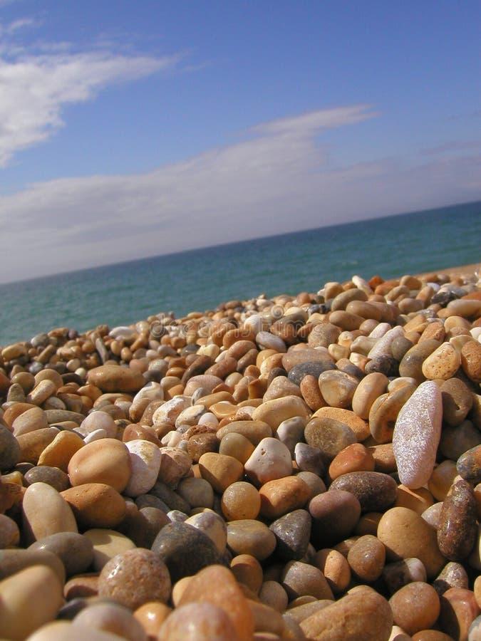 Het strand van de kiezelsteen stock afbeelding