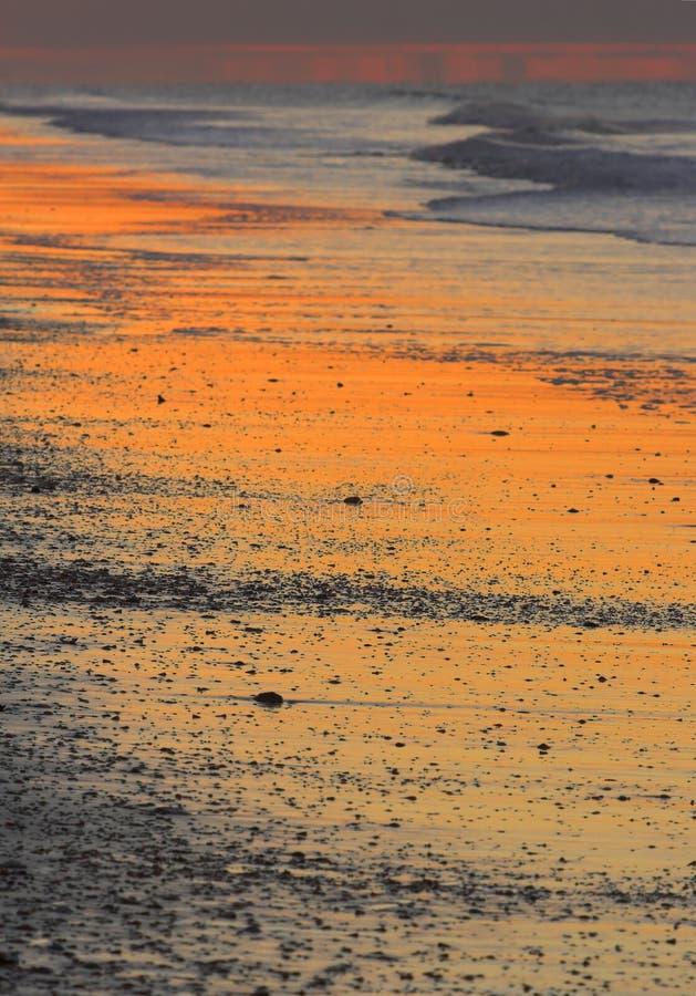Het strand van de zonsopgang stock foto
