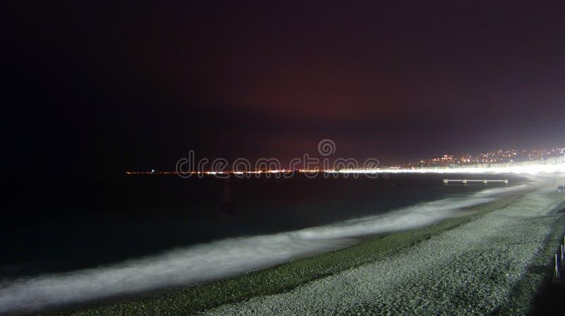Het Strand Van Nice Bij Nacht Stock Afbeeldingen