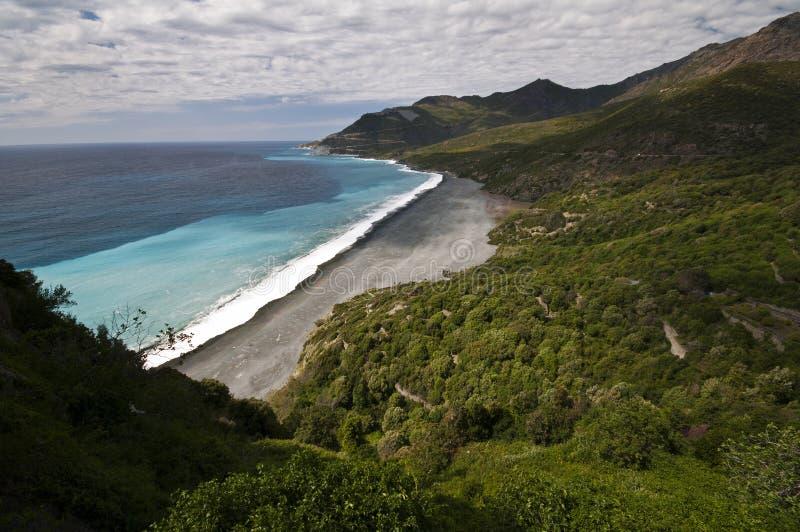 Het strand van Nonza stock fotografie