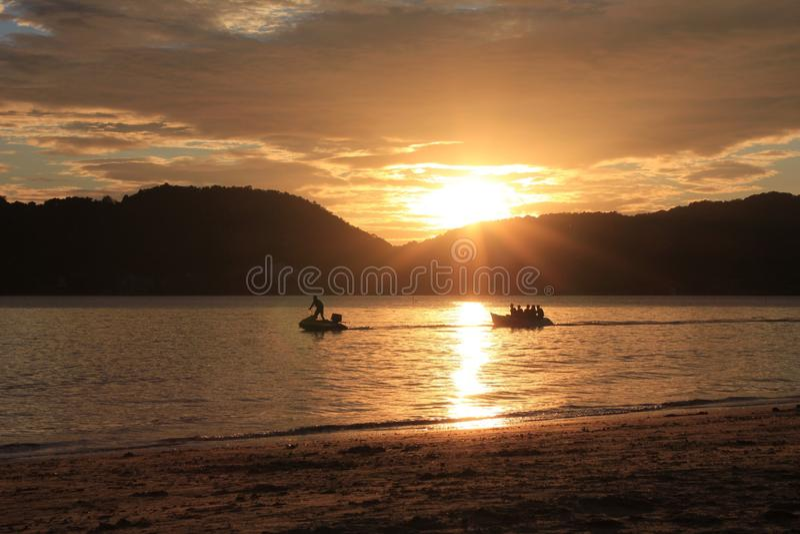 Het Strand van zonsondergangleamsing royalty-vrije stock foto