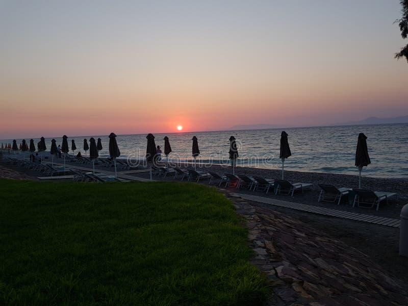 het strand van zonsondergangrhodos royalty-vrije stock foto's