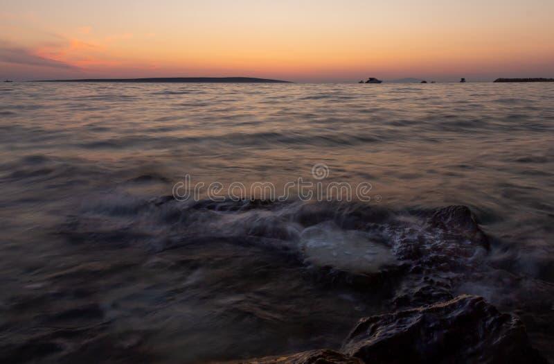 Het Strand van zonsopgangkroatië met Pastelkleuren royalty-vrije stock afbeelding