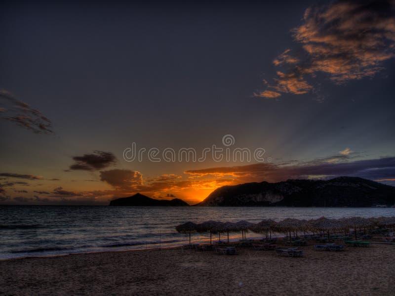 Het strandzonsondergang van Korfu - Agios Georgios- royalty-vrije stock afbeelding