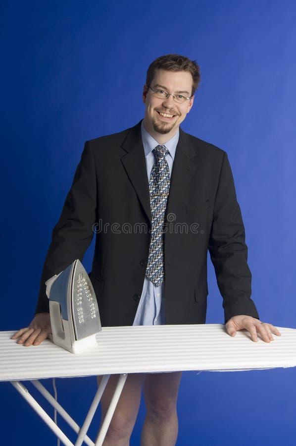 Het strijken van de zakenman stock foto