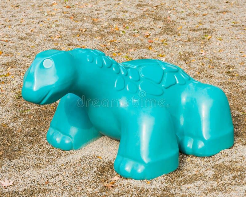 Het Stuk speelgoed van de Dinosaurus van de speelplaats stock afbeelding