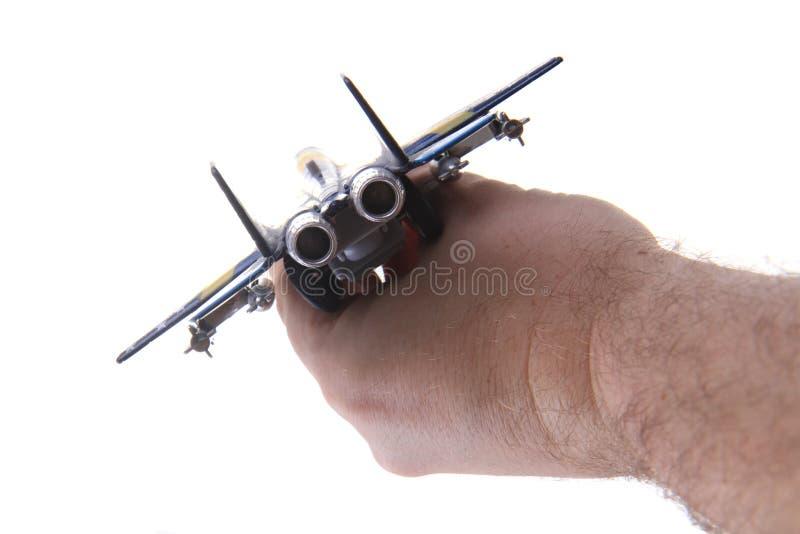 het stuk speelgoed van de luchtvechter in menselijke hand royalty-vrije stock foto's