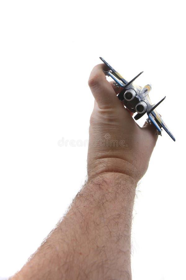 het stuk speelgoed van de luchtvechter in menselijke hand stock foto