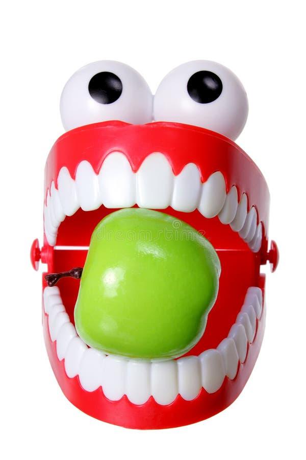 Het Stuk speelgoed van de Tanden van Chattering met Appel stock foto's
