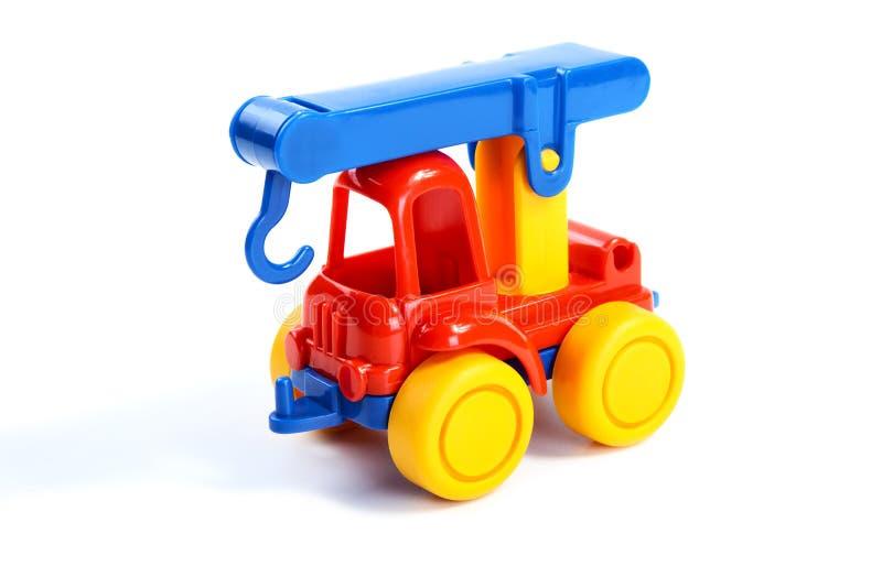 Het stuk speelgoed van kinderen de auto-kraan stock foto