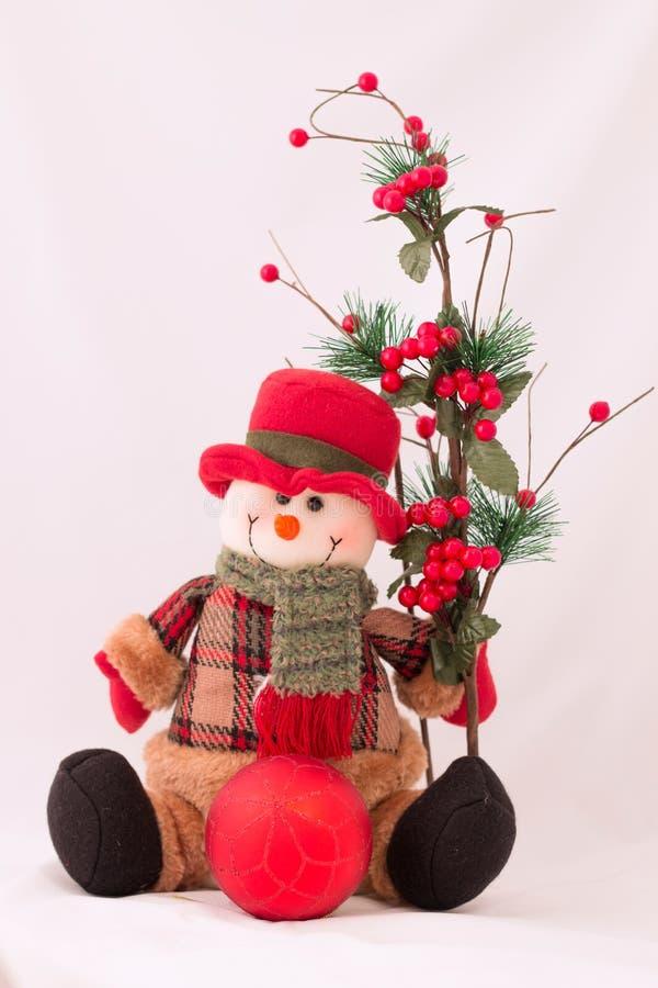 Het stuk speelgoed van sneeuwmankerstmis op witte achtergrond stock afbeeldingen