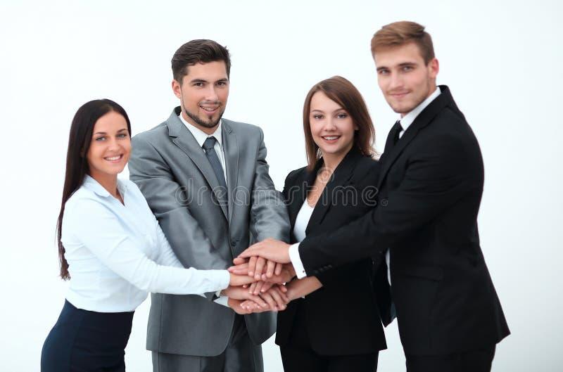 Het succesvolle commerciële team met vouwde samen zijn handen stock afbeelding