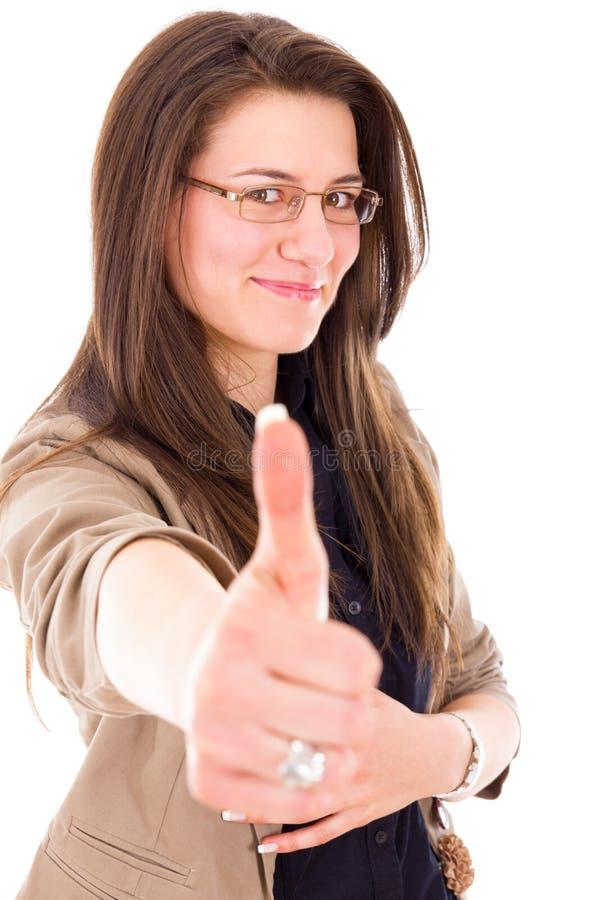 Het succesvolle jonge bedrijfsvrouw tonen beduimelt omhoog royalty-vrije stock foto