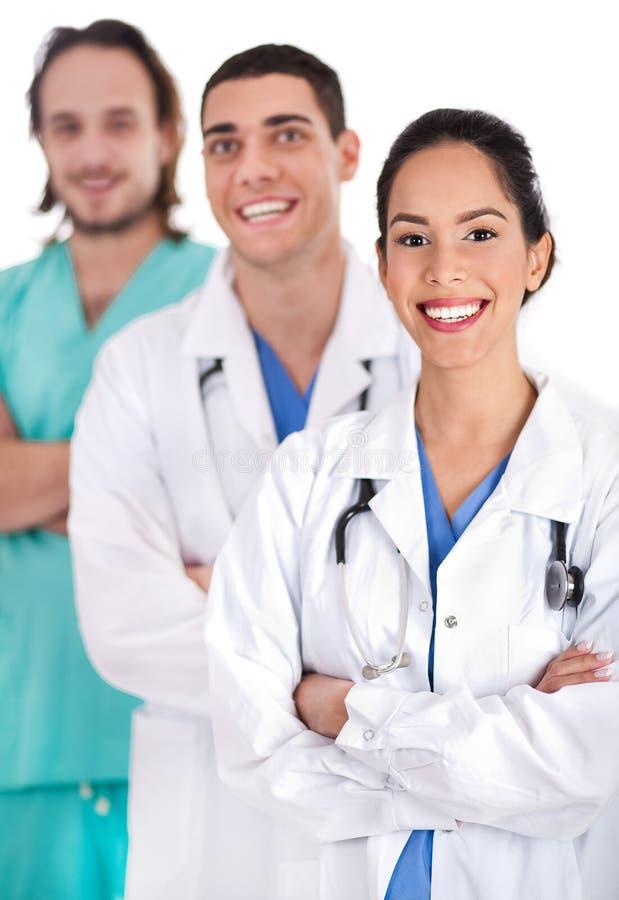 Het succesvolle jonge doctos glimlachen stock afbeeldingen