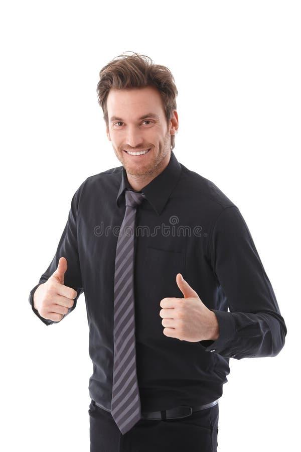 Het succesvolle zakenman glimlachen beduimelt omhoog royalty-vrije stock foto