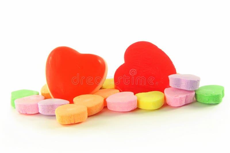 Het suikergoed van de hartvorm op witte achtergrond royalty-vrije stock afbeeldingen