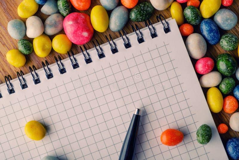 Het suikergoed van het pennotitieboekje stock afbeeldingen