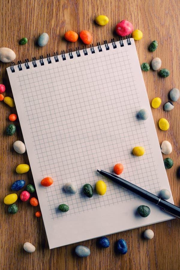 Het suikergoed van het pennotitieboekje stock fotografie