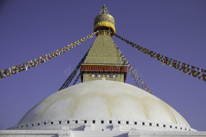 Het symbool van Vrede is Boedha Boudhanath is plaats waar de Boeddhistische mensen om rond tot aan hun Lord Boedha gebruiken te m stock afbeelding