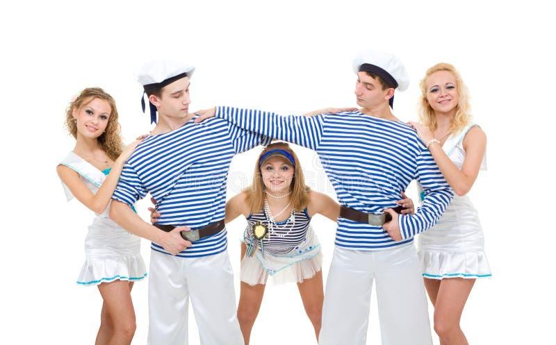 Het team dat van de dans zeeman het eenvormige dansen draagt stock foto