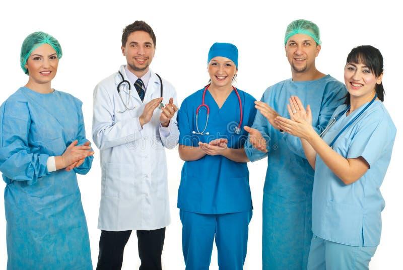 Het team van artsen het toejuichen royalty-vrije stock afbeeldingen
