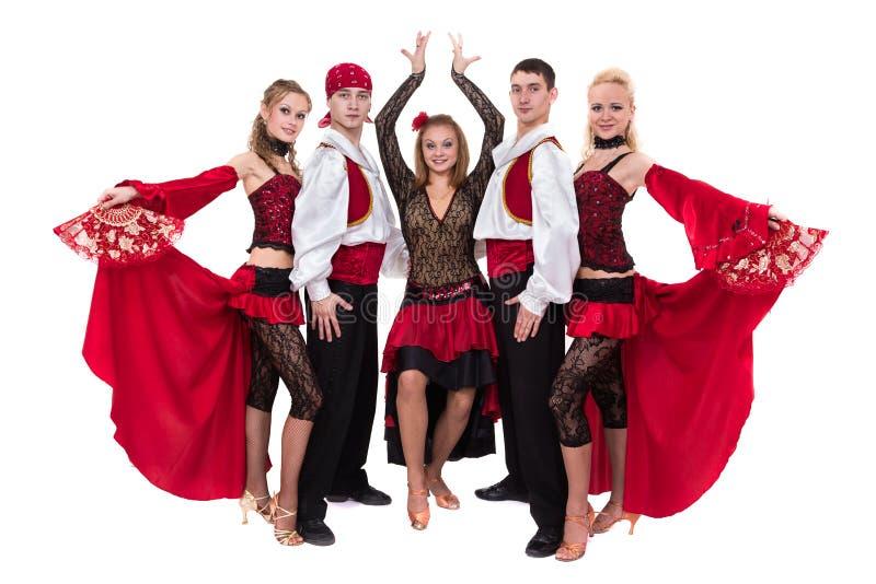 Het team van de Flamenkodanser dansen geïsoleerd op witte achtergrond stock fotografie