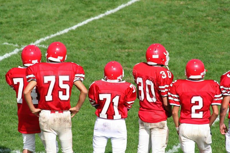 Het Team van de Voetbal van de middelbare school stock foto's