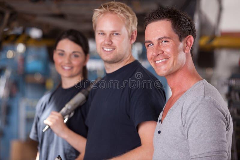 Het Team van werktuigkundigen stock afbeelding