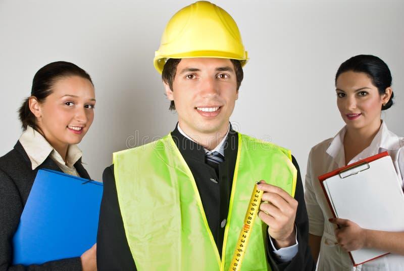 Het teammensen van arbeiders stock afbeelding