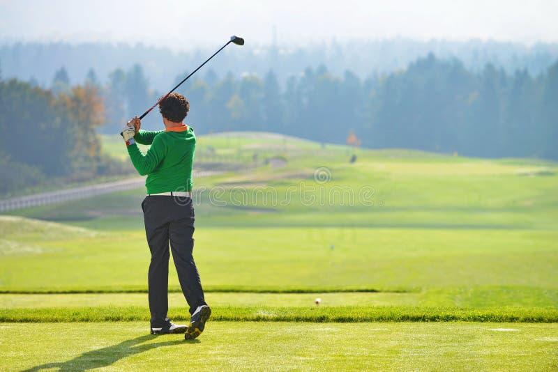 De schommeling van de golfspeler stock foto